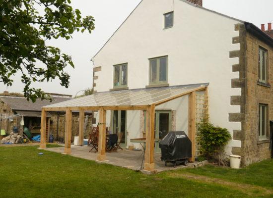een veranda maken met een plat of schuin dak